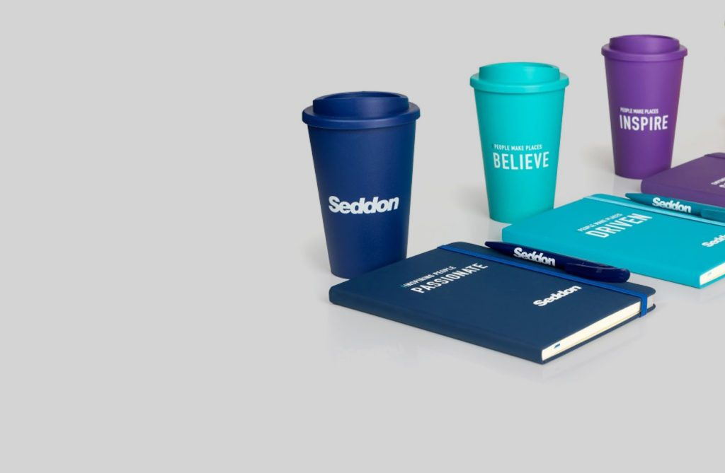 branded cups and notebooks