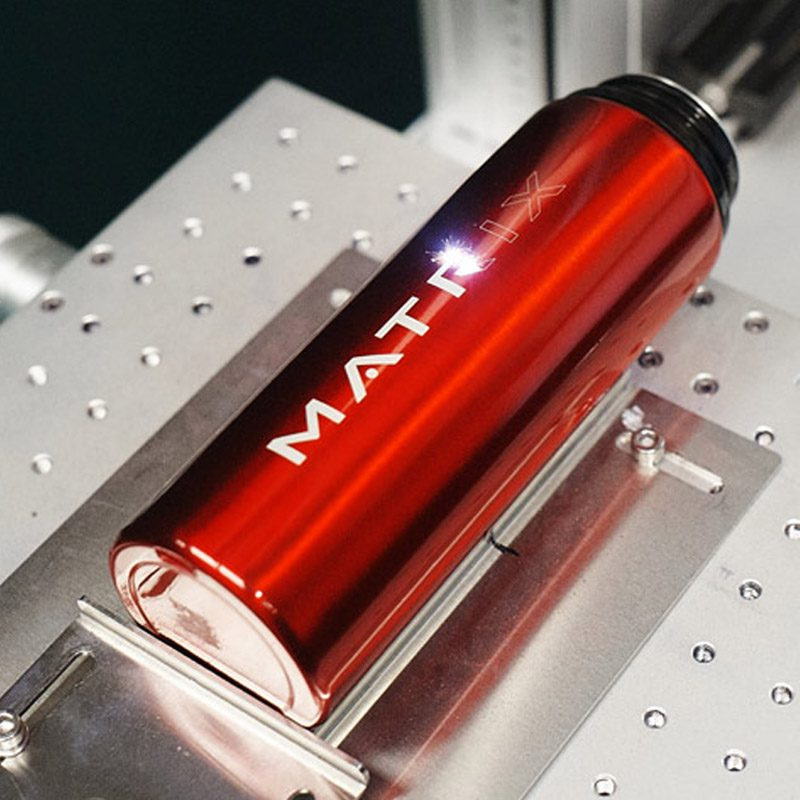 an image of a branded water bottle being manufactured
