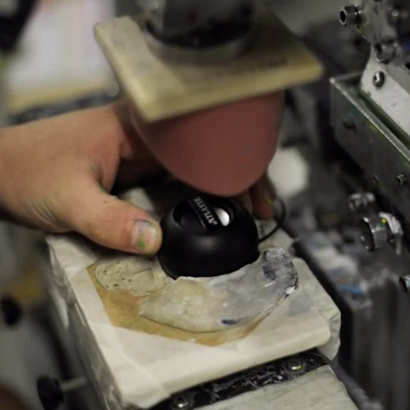 an image of a piece of branded merchandise being manufactured