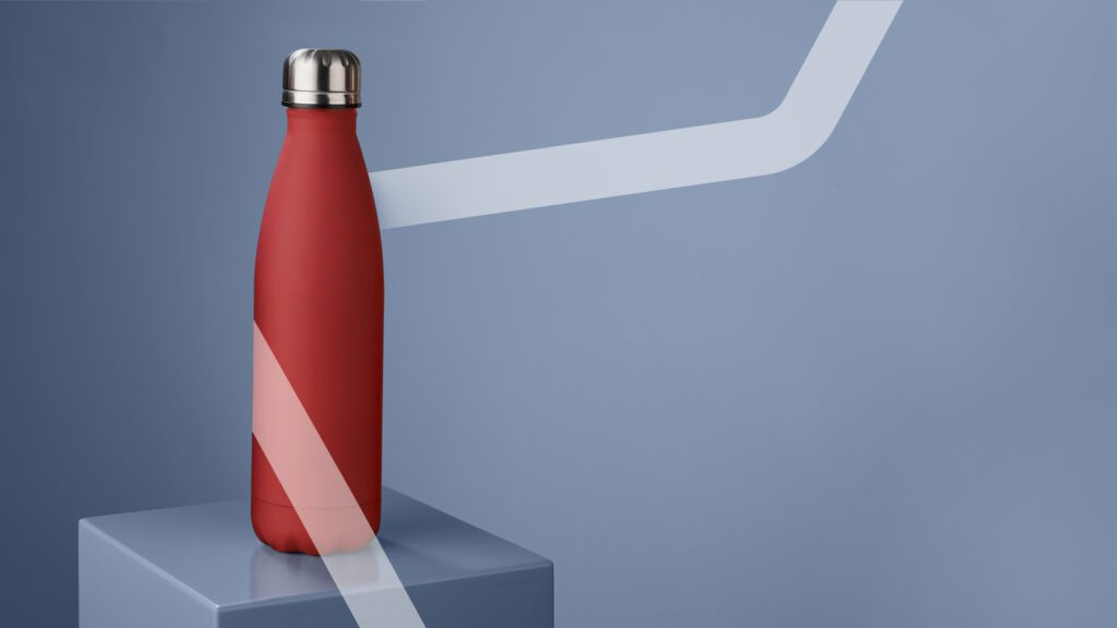Red thermal bottle on plinth with transparent line super imposed over image.