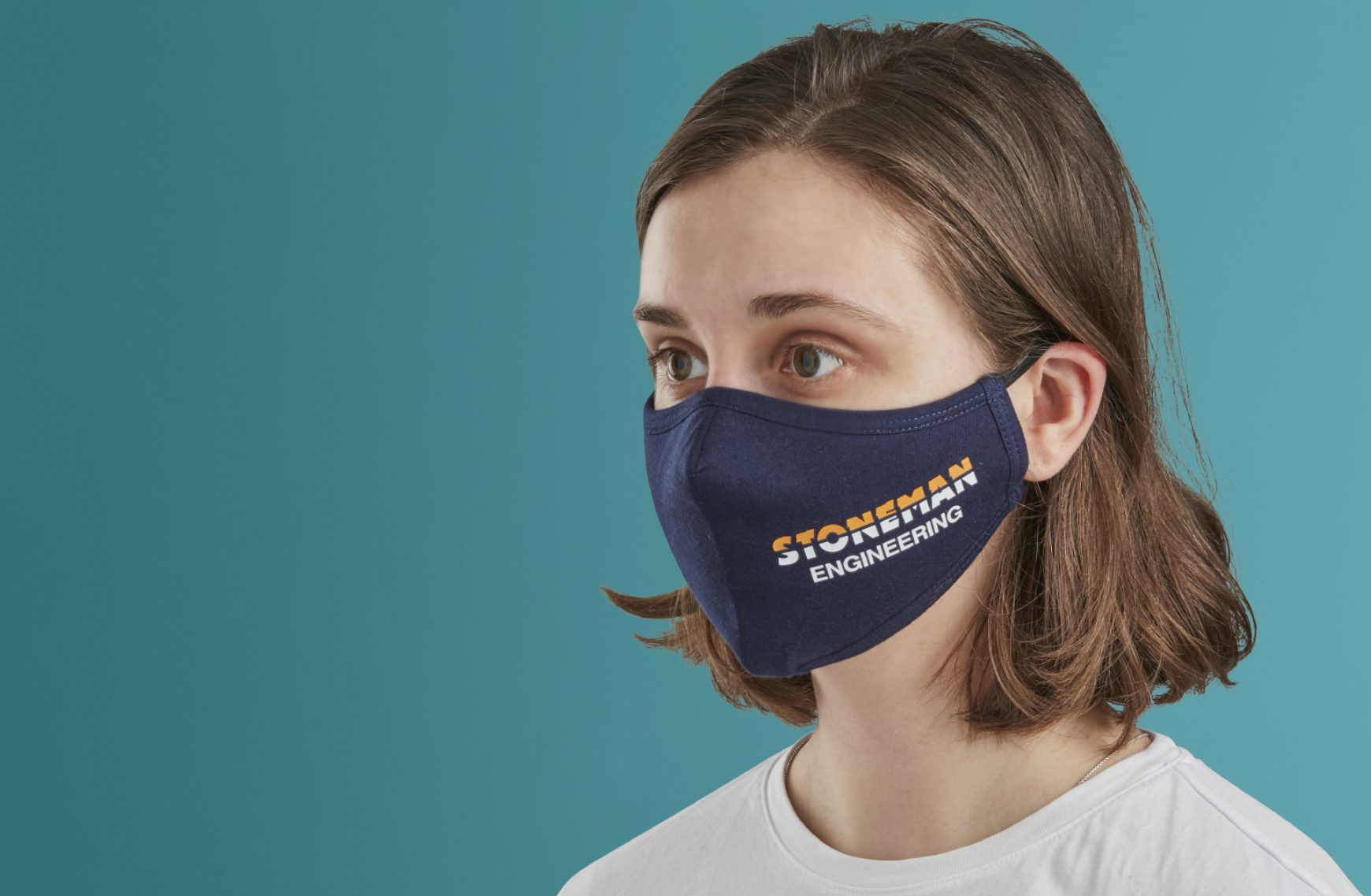 Woman wearing branded ppe mask
