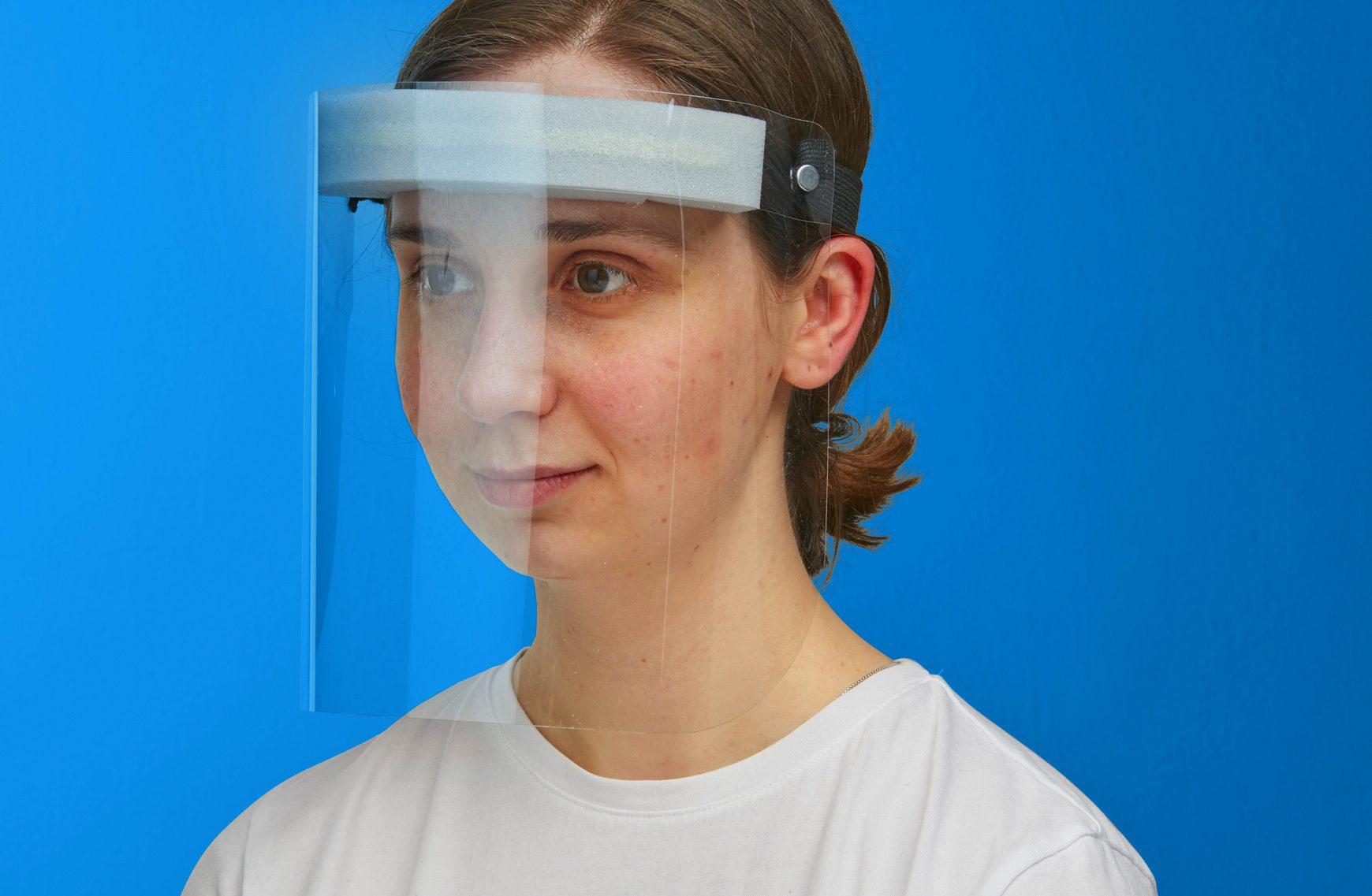 Woman wearing ppe face visor