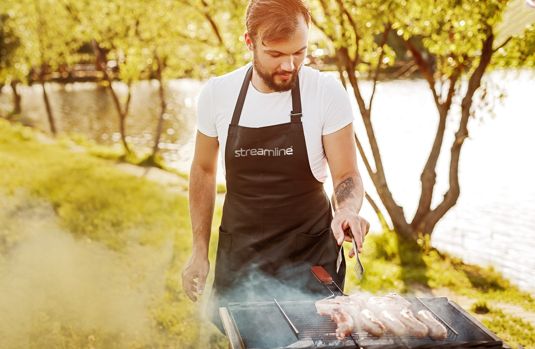 Man wearing summer promotional products at a bbq
