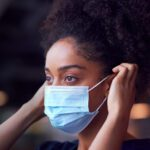 Image of woman donning and doffing ppe